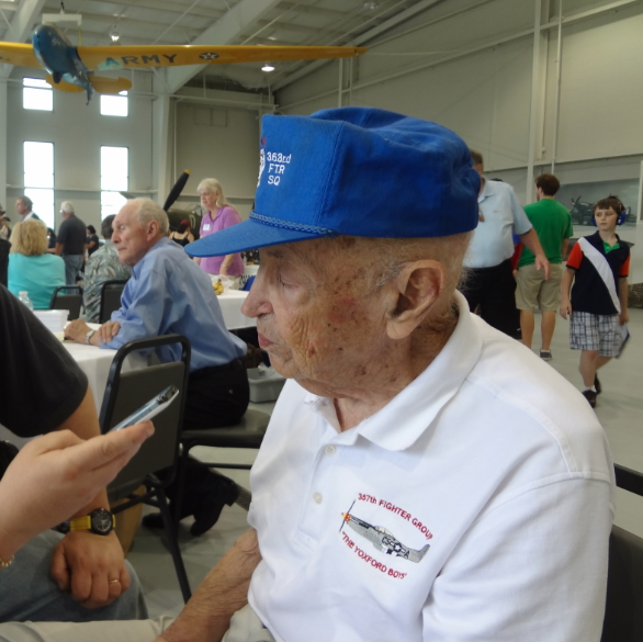 Interviewing living legend, Bill Overstreet at Warbirds Over the Beach. Photo by anonymous (2013). Courtesy of Warbirds News.