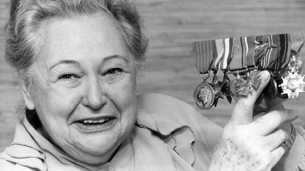 Nancy Wake – The White Mouse shows off her medals. Photo by anonymous (c. 1994). Courier Mail—Wikimedia.