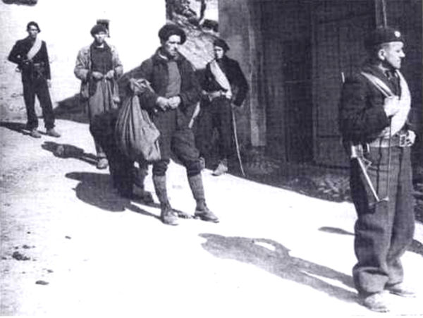 Arrest of maquisards by the French Milice (the French Gestapo). Photo by anonymous Milicien (22 February 1944). PD-70+ Wikimedia Commons.