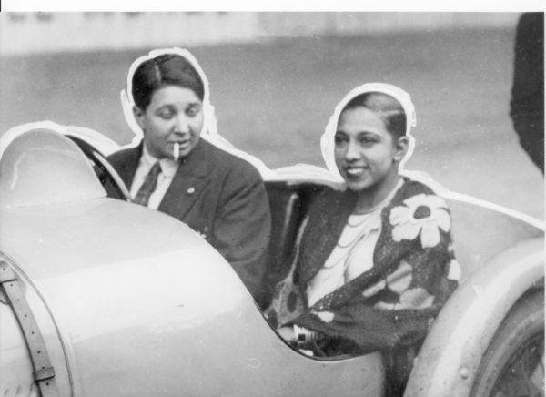 Josephine Baker in the passenger seat with Nazi agent, Violette Morris behind the wheel. Photo by anonymous (c. 1930s). Author's collection.