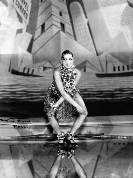 Josephine Baker dancing the Charleston at the Folies-Bergère, Paris. Photo by Lucien Waléry (c. 1926). PD-70+. Wikimedia Commons.