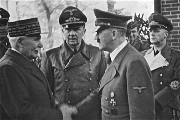 Marshal Pétain meeting Adolf Hitler. Translator in center and von Ribbentrop on the right. Photo by Heinrich Hoffmann (24 October 1940). Bundesarchiv, Bild 183-H25217/CC-BY-SA 3.0. Wikimedia Commons.