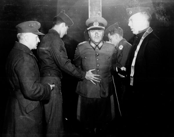 German General Anton Dostler is tied to a stake before his execution by firing squad. Photo by Blomgren (1 December 1945). National Archives. PD-US Government. Wikimedia Commons.