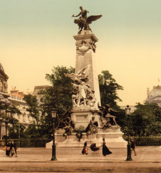 The Gambetta Monument originally located in the Carousel du Louvre. Notice the building on the left. This is the Richelieu Pavilion of the Louvre. The trees in the background have been replaced by the I.M. Pei Pyramid. Photo by anonymous (c. 1900). Author's collection.