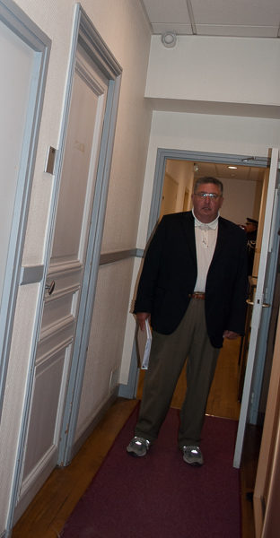 Stew standing in the hallway of the former headquarters of the Gestapo. Cell doors lined the hallway. Photo by Sandy Ross.