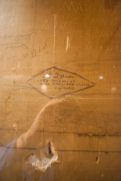 Prisoner's graffiti from the interior of the holding cell at the former headquarters of the Gestapo. Photo by Sandy Ross.