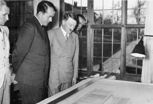 Adolf Hitler and Albert Speer (second from left) at Obersalzberg looking at a plan for the new Opera of Linz. Photo by Heinrich Hoffmann (21 June 1939). Bundesarchiv, Bild 183-2004-1103-500/CC-BY-SA 3.0. PD-Creative Commons Attribution-Share Alike 3.0 Germany. Wikimedia Commons.
