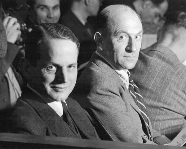 Defendants Otto Ohlendorf (left) and Heinz Jost (right) in the dock for the Einsatzgruppen Trial (Case 9). Accused of commanding Einsatzgruppen units for the purpose of exterminating Jews, Roma (gypsies), and other civilians in the Eastern territories. Both were found guilty: Ohlendorf was hanged and Jost given life sentence—released in 1951). Photo by US Army (9 February 1948). PD-US Government. Wikimedia Commons.