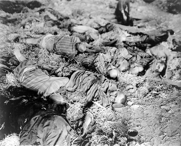 Dead workers found by American 3rd Armored Division when it captured the German slave labor camp. Photo by U.S. Army (11 April 1945). PD-US Government. Wikimedia Commons.