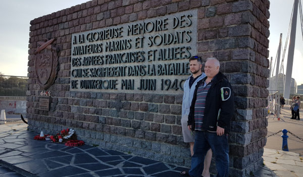 Denis Caron (left) and his father next to Dunkirk monument. Photo by Janet O'Rourke (November 2017).